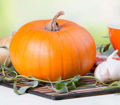 Pumpkin soup with fresh pumpkins, cooking concept