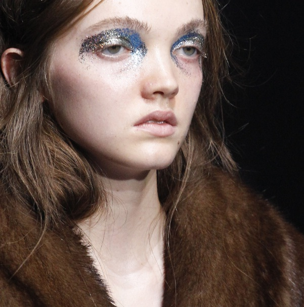 7d5671181bb The fierce statements crafted by makeup artist Yadim also involved  shimmering eye makeup in mermaid tones. Gold and blue glitter eyeshadow was  applied ...