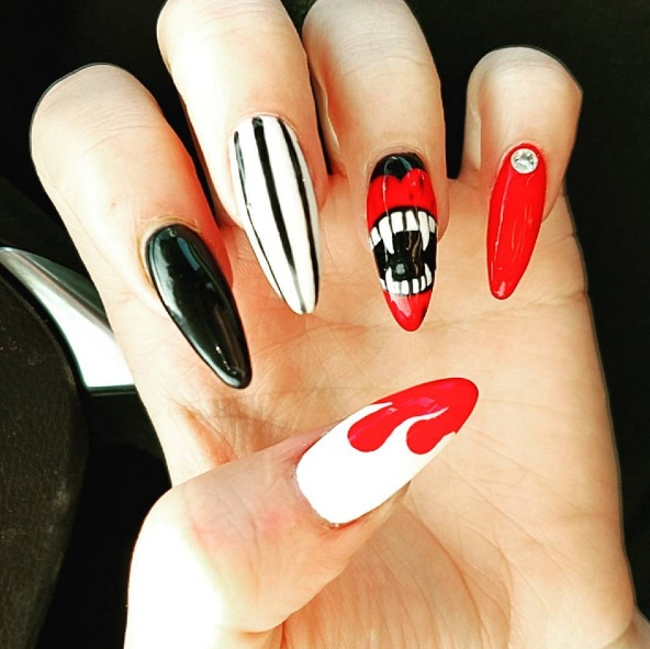 Spooktacular halloween nail art looks beauty whether you use faux nails or create the nail art yourself miniature rhinestones will get your seasonal manicure perfected for a night out solutioingenieria Image collections