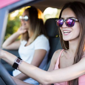 Hipster Women driving Car On Road Trip